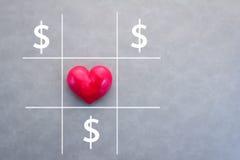 L'amour est un concept de gain de jeu avec le jeu de dessin avec le coeur et Photos stock