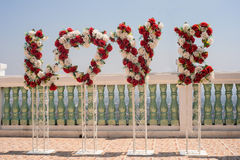 L'amour fleurit le signe Photo stock