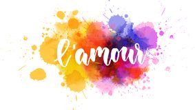 L'amour lettering on watercolor paint splash. L'amour - Love in French language. Handwritten modern calligraphy lettering text on multicolored stock illustration