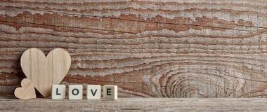 L'amour se connectent le fond en bois Image libre de droits