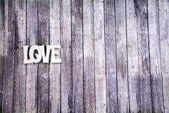 L'amour se connectent le plancher en bois Photos stock