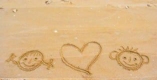 L'amour sourit sur le sable Photographie stock libre de droits