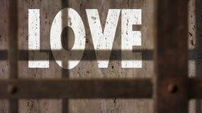 L'amour sur un mur avec la prison barre l'ombre Image libre de droits