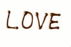 L'amour wrtitten avec du chocolat fondu Photographie stock