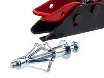 L'ancre d'expansion en métal assemble avec des goujons pour la cloison sèche photos stock