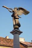 L'angelo che gioca il corno Immagini Stock