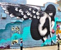 L'angelo traversa l'etichetta volando fotografia stock libera da diritti