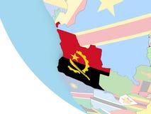 L'Angola avec le drapeau sur le globe Photos libres de droits