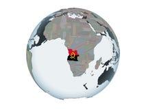 L'Angola avec le drapeau sur le globe d'isolement illustration stock