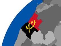L'Angola avec le drapeau sur le globe politique Photo stock