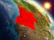 L'Angola dans le lever de soleil de l'orbite illustration stock