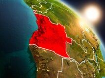 L'Angola de l'espace pendant le lever de soleil illustration de vecteur