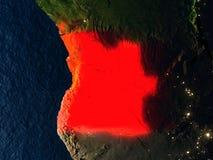 L'Angola en rouge de l'espace la nuit Photographie stock