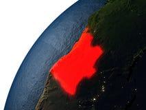 L'Angola en rouge sur terre la nuit Images libres de droits