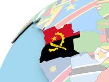L'Angola sur le globe avec le drapeau Photographie stock