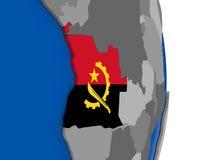 L'Angola sur le globe avec le drapeau Image stock