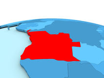 L'Angola sur le globe bleu Image stock