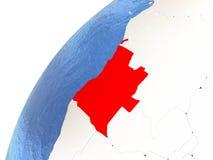 L'Angola sur le globe métallique avec les océans bleus Images stock