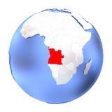 L'Angola sur le globe métallique d'isolement Photo libre de droits