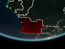 L'Angola sur terre de l'espace la nuit illustration de vecteur