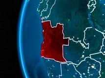 L'Angola sur terre la nuit Image stock