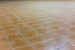 L'angolo del pavimento di marrone del quadrato delle mattonelle Immagine Stock Libera da Diritti