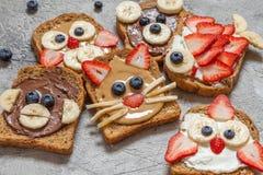 L'animale divertente affronta i pani tostati Immagini Stock Libere da Diritti