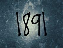 L'année 1891 écrite sur le vieux fond de cru photos stock