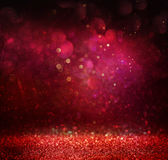 L'annata di scintillio accende il fondo oro, rosso e porpora defocused Fotografie Stock Libere da Diritti