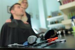 L'annata foggia il negozio di barbiere immagini stock