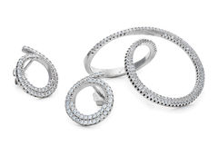 L'anneau et les paires peu communs d'argent de forme cloutent des boucles d'oreille avec des diamants Photographie stock