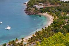 L'Antigua, Antigua e Barbuda, una spiaggia in porto inglese Fotografie Stock Libere da Diritti