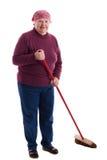 L'anziano scopa il pavimento Immagini Stock