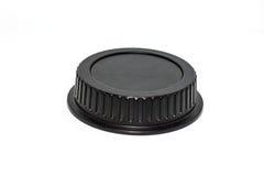 L'appareil-photo noir de cercle len le chapeau sur le fond blanc Photo libre de droits