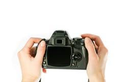 l'appareil-photo remet la femme photographie stock