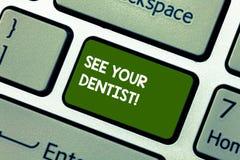 L'apparence conceptuelle d'écriture de main voient votre photo de Business de dentiste présenter pour aller à examiner à qui est  photographie stock