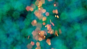 L'arancia scintilla contro le forti luci verdi e blu del bokeh Fotografia Stock Libera da Diritti
