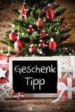 L'arbre de Noël avec l'effet de Bokeh, Geschenk Tipp signifie l'astuce de cadeau Photos libres de droits