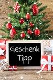 L'arbre de Noël coloré, flocons de neige, Geschenk Tipp signifie l'astuce de cadeau Images libres de droits