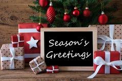 L'arbre de Noël coloré, texte assaisonne des salutations Image stock