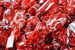 L'arbre de Noël européen de sucrerie de Noël ornemente le sucre de gelée avec du chocolat dans l'aluminium rouge brillant Images stock
