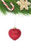 L'arbre de sapin de Noël a décoré la canne d'esprit, le snowlake et le scintillement rouge Images libres de droits