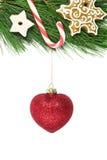 L'arbre de sapin de Noël a décoré la canne d'esprit, le snowlake et le scintillement rouge Image stock