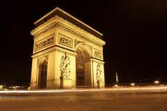 L'Arc DE Triomphe bij Nacht Stock Foto