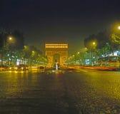 L'Arc de Triomphe, Paris. L'Arc de Triomphe at night with traffic in Paris Stock Images