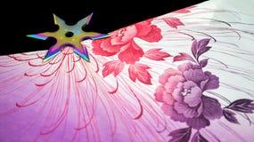 L'arc-en-ciel shuriken images libres de droits