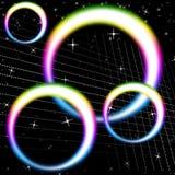 L'arcobaleno circonda la circolare variopinta ed i cieli di mezzi del fondo Fotografia Stock Libera da Diritti
