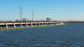 L'area sommersa causata da alta marea livella nel fiume adiacente Immagine Stock Libera da Diritti