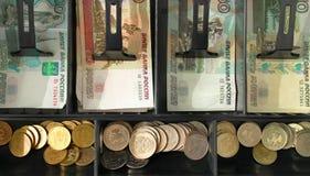 L'argent dans le s'inscrire Photographie stock libre de droits
