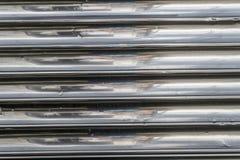 L'argento allinea la vecchia struttura del fondo del metallo Immagini Stock